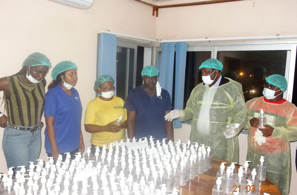 Rt. Rev. Fonki Samuel Forba, Moderator PCC visits the PCC Central Pharmacy to encourage staff as they produce hand sanitizers to combat COVID19 Coronavirus